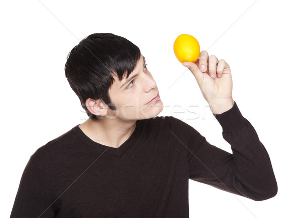 Caucasian man examining a lemon Stock photo © dgilder