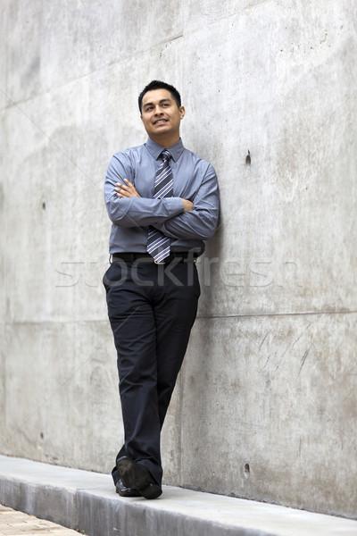 Hispanic бизнесмен конкретные стены складе Сток-фото © dgilder