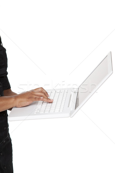 Businesswoman - Latina laptop typing Stock photo © dgilder