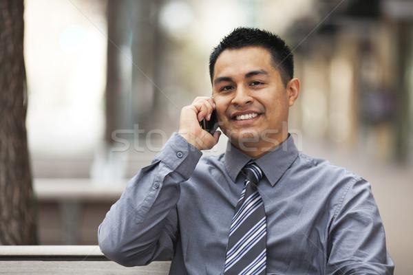 Hispanic бизнесмен сотового телефона складе фото Сток-фото © dgilder