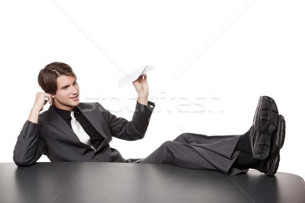 бизнесмен скучно бумажный самолетик изолированный ног Сток-фото © dgilder