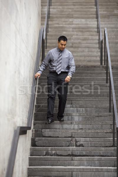 Latino zakenman lopen beneden trappenhuis voorraad Stockfoto © dgilder
