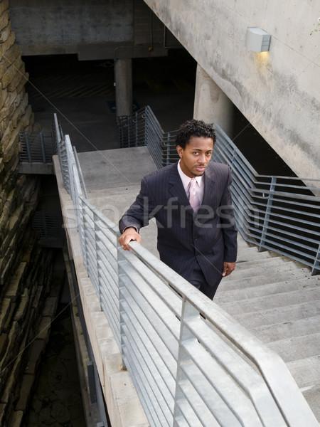 Sério empresário escada três peça terno Foto stock © dgilder