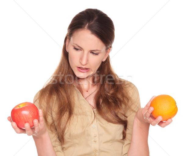 деловая женщина яблоко оранжевый выбора изолированный Сток-фото © dgilder