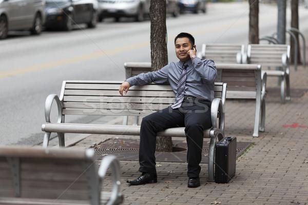 Сток-фото: Hispanic · бизнесмен · сотового · телефона · складе · фото