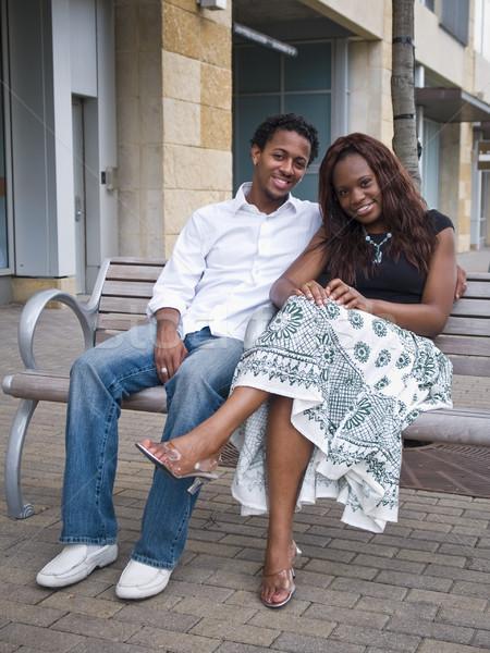 сидят вместе молодые афроамериканец пару Сток-фото © dgilder