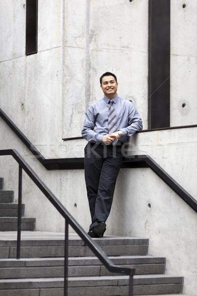 Spanyol üzletember dől lépcső sín stock Stock fotó © dgilder