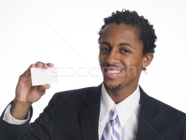 Empresário feliz cartão em branco isolado estúdio cabeça Foto stock © dgilder