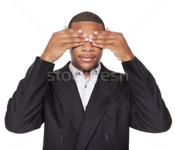 Stock photo: See No Evil - African American businessman isolated on white