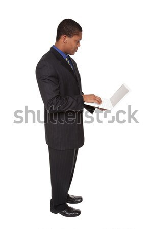 businessman - confident laptop Stock photo © dgilder