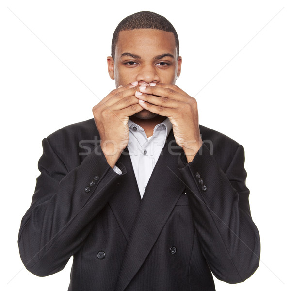 Stock photo: Speak No Evil - African American businessman isolated on white