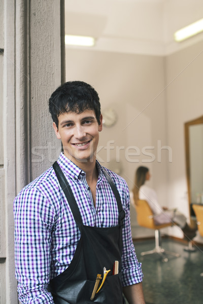 portrait of man working as hairdresser and smiling Stock photo © diego_cervo