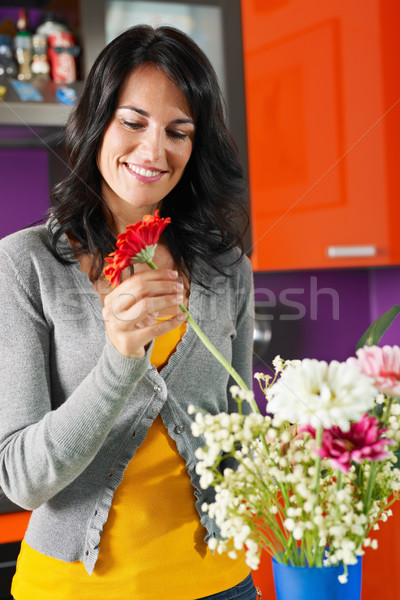 woman arranging flowers in pot Stock photo © diego_cervo