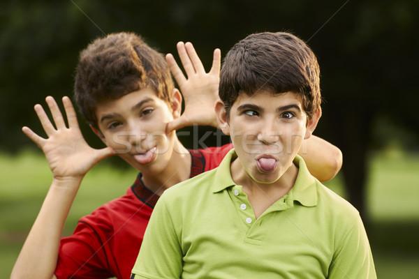Szczęśliwy hiszpańskie chłopców grymas kamery Zdjęcia stock © diego_cervo