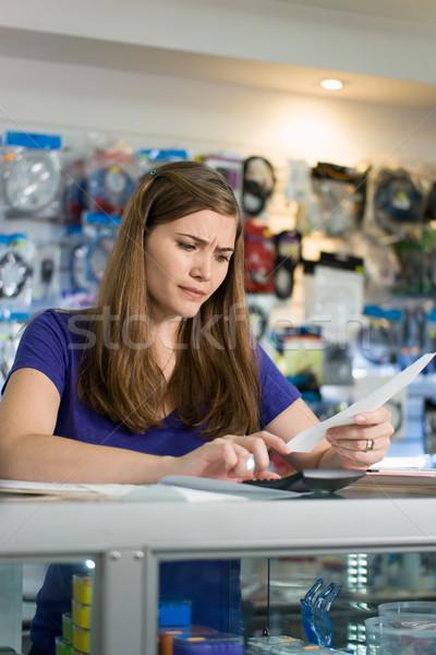 Endişeli kadın hesap makinesi genç Stok fotoğraf © diego_cervo