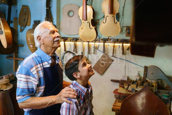 Old Man Grandpa Showing Guitar To Boy Grandson Stock photo © diego_cervo