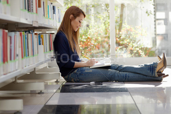 Stock photo: girl studying on floor in library
