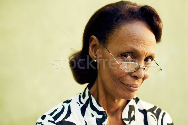 Portrait of confident old black lady with eyeglasses smiling Stock photo © diego_cervo