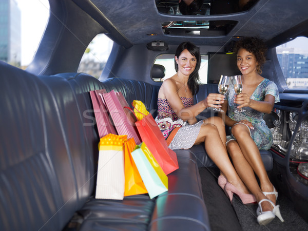 women drinking wine in limousine Stock photo © diego_cervo