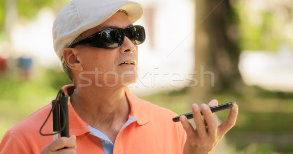Blind Man Talking With Mobile Phone Disabled Man Speaking Stock photo © diego_cervo
