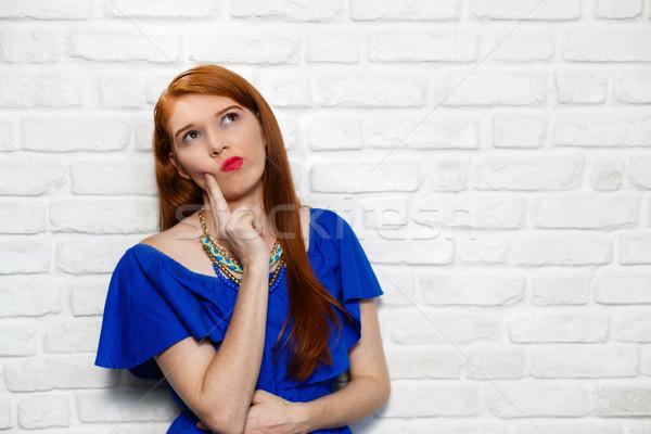 Arckifejezések fiatal vörös hajú nő nő téglafal portré Stock fotó © diego_cervo
