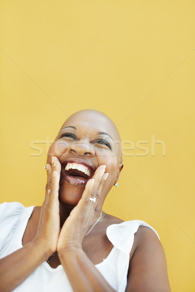 mature african woman smiling for joy  Stock photo © diego_cervo