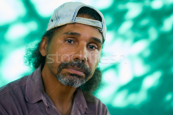 Anxious Latino Man With Sad Worried Face Expression Stock photo © diego_cervo