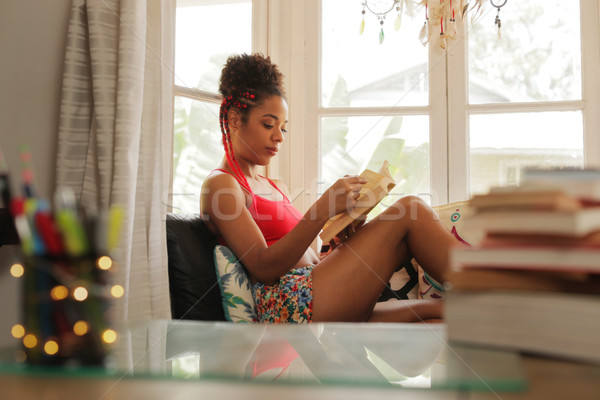African American Woman Reading Book At Home Near Window Stock photo © diego_cervo