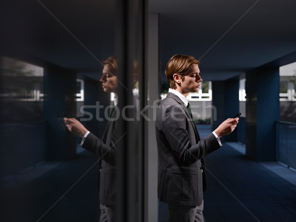 businessman reading emails on smartphone outdoor Stock photo © diego_cervo