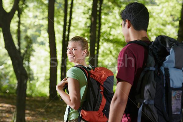 Couple sac à dos trekking bois jeune homme femme Photo stock © diego_cervo