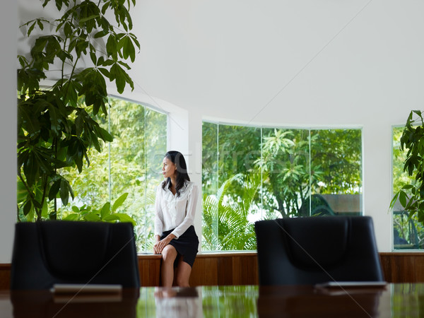 businesswoman contemplating out of window in meeting room Stock photo © diego_cervo