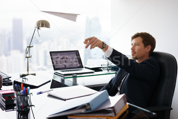 Daydreaming Successful Man Office Worker Throwing Paper Airplane Stock photo © diego_cervo