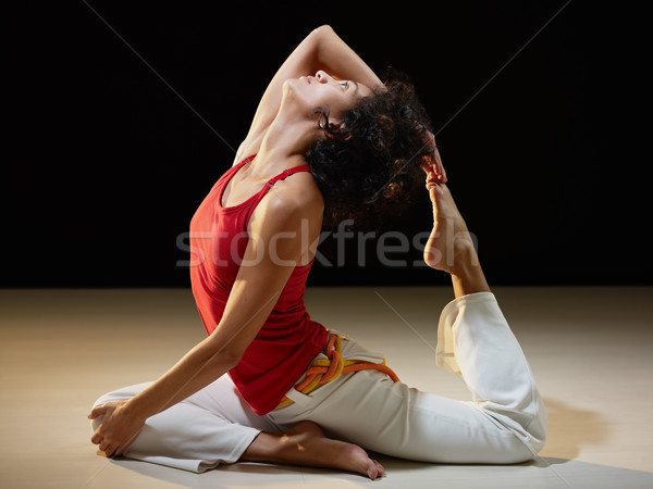 hispanic woman doing stretching and yoga Stock photo © diego_cervo