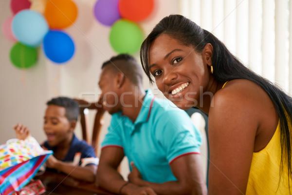 Latino Family With Man Woman Child Celebrating Birthday At Home Stock photo © diego_cervo