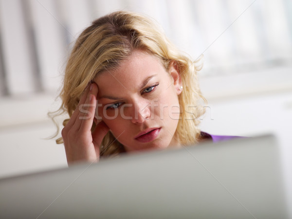 Stock photo: Headache and health problems for young woman at work