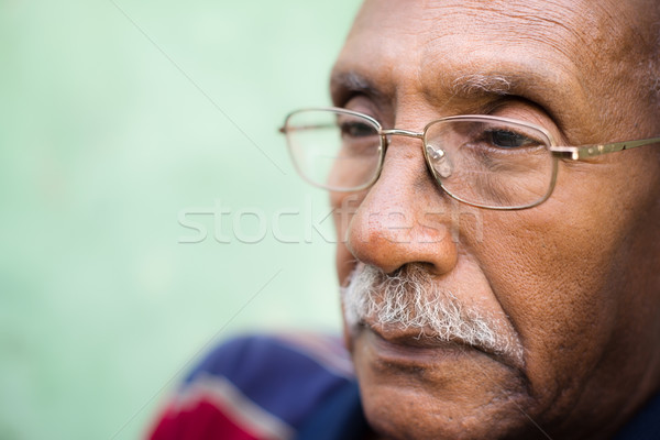 Worried senior african american man with eyeglasses Stock photo © diego_cervo