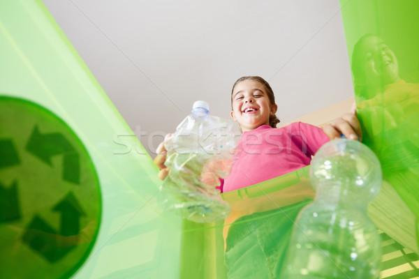 девушки рециркуляции пластиковых бутылок внутри Сток-фото © diego_cervo