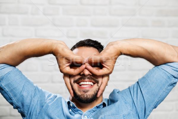 Expressions faciales jeunes barbe homme mur de briques portrait Photo stock © diego_cervo