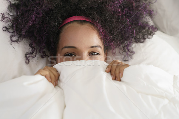 Beautiful Happy Hispanic Teen Waking Up And Smiling Undercover Stock photo © diego_cervo