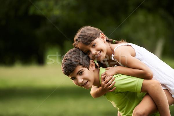 Gyerekek fiú lány szeretet fut háton Stock fotó © diego_cervo