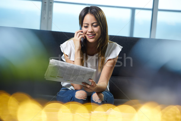 Woman Phone Calling For Job Announcement On Newspaper Stock photo © diego_cervo