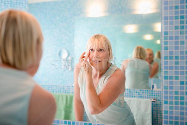 Női szépség öreg nő krém arc Stock fotó © diego_cervo