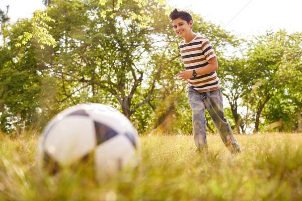 Młody chłopak gry piłka nożna gry piłka adolescencja Zdjęcia stock © diego_cervo