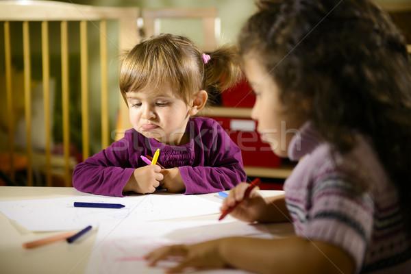 Stock photo: Children and fun, two preschoolers drawing in kindergarten