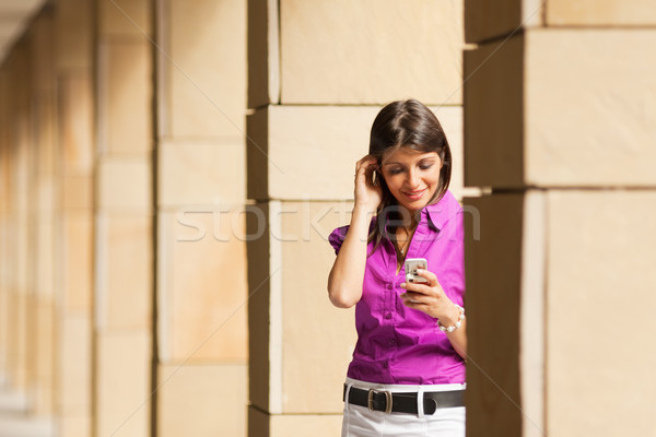 Stock photo: woman using mobile phone
