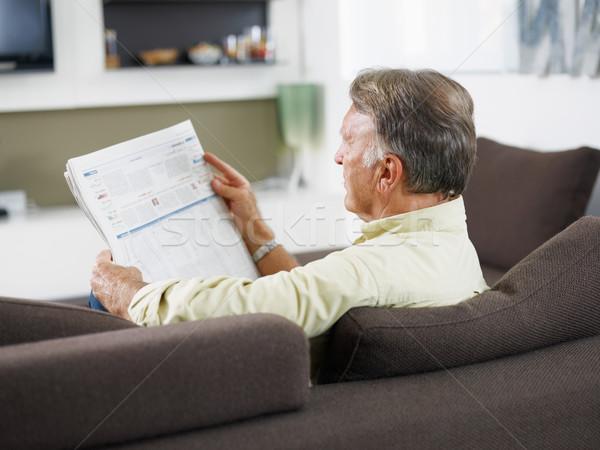 Kıdemli adam okuma gazete oturma kanepe Stok fotoğraf © diego_cervo