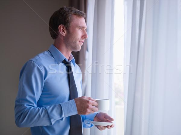 Stockfoto: Zakenman · drinken · koffie · naar · uit · venster
