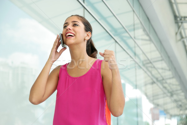 Young Woman On The Phone Smiling For Joy Stock photo © diego_cervo