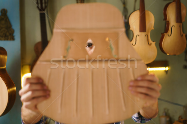 Artisan Lute Maker Chiseling Guitar Inspecting Holes In Acoustic Stock photo © diego_cervo
