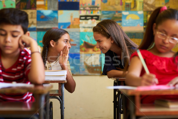 Stock photo: Girls Cheating During Admission Test In Class At School